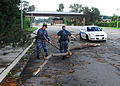 US Navy 110828-N-BJ275-001 Sailors assigned to the base police department move debris from Hurricane Irene at one of the entrances to Joint Expedit.jpg