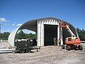 US Navy 110914-N-OP745-002 Seabees assigned to Naval Mobile Construction Battalion (NMCB) 11 work on an inert ordnance storage building for Navy Mu.jpg