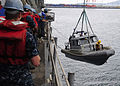 US Navy 111101-N-WJ771-098 Sailors assigned to the forward-deployed amphibious dock landing ship USS Germantown (LSD 42) lower a rigid-hull inflata.jpg