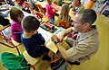 US Navy 111103-N-PE825-166 Navy chief reads with students at Kostrena Elementary School.jpg