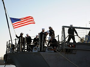 US Navy 111214-N-TC587-014 Sailors aboard the USS Samuel B. Roberts hoist the American flag.jpg