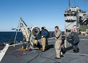 US Navy 120130-N-NR955-046 Insitu and Boeing contractors prepare the unmanned aerial vehicle Scan Eagle for a test flight from the flight deck aboa.jpg