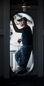 US Navy 120202-N-OY799-035 Seaman George Pulley stands lookout watch on the fantail aboard the Nimitz-class aircraft carrier USS John C. Stennis (C.jpg