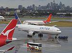 United 777 at SYD (26339047245).jpg