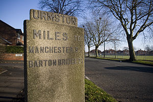 Urmston - A milestone erected to commemorate the opening of Bowfell Road, in 1937