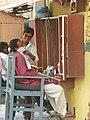 Varanasi 43 - street barber shop (24146751198).jpg