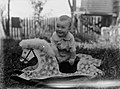 View of a baby on a rocking horse (AM 80593-1).jpg