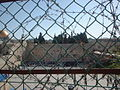 Western wall through fence.JPG