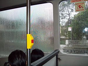 Wrap advertising - Shows how wet bus wrap distorts the view from inside through wrapped bus windows. The window on the left has a wrap advertisement on the outside whereas the window on the right does not.