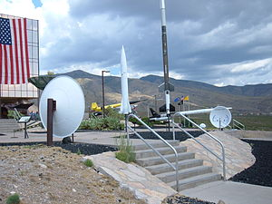 New Mexico Museum of Space History - Displays at front entrance: sounding rockets used at Alamogordo and whisper dishes