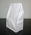 White paper bag on white and black background.jpg