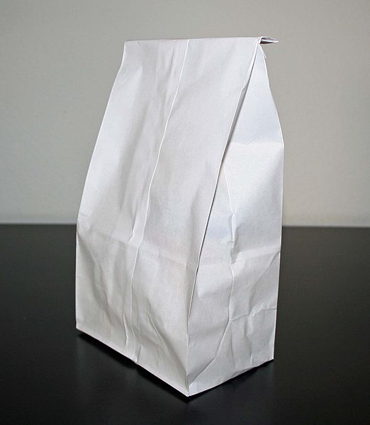 A white paper bag on white and black background