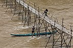 Working at the consolidation of a wooden footbridge in Luang Prabang - 3 (Three-quarter view).jpg
