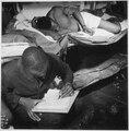 """... sailors in their bunkroom aboard the U.S.S. Ticonderoga (CV-14) on eve of the Battle of Manila, PI. Thomas L. Crens - NARA - 520867.tif"