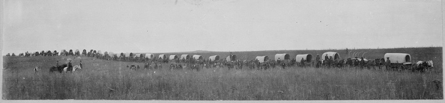 "Indian teams hauling 60 miles to market the 1100 bushels of wheat raised by the school at Seger Colony, Oklahoma Territory, circa 1900. ""Indian teams hauling 60 miles to market the 1100 bushels of wheat raised by the school. It brought four cents more than - NARA - 519190.tif"