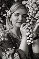 День Вишиванки. Молода україночка у вишитій синій сукні серед квітів 04.jpg