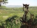 015 Escultura El marge dels oficis, de Luis Zafrilla (Castellet), al fons els camps de la Timba.jpg