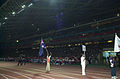 141100 - Closing Ceremony athletics competitor Neil Fuller flag bearer 2 - 3b - 2000 Sydney closing ceremony photo.jpg