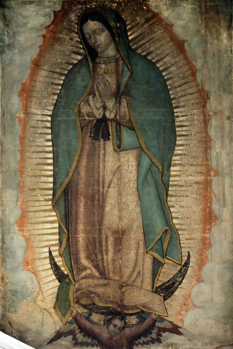 By unknown (1531 presented by Juan Diego) (Nueva Basílica de Nuestra Señora de Guadalupe) [Public domain], via Wikimedia Commons.
