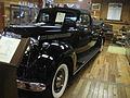 1938HenneyPackardEight886FlowerLeftSide.jpg