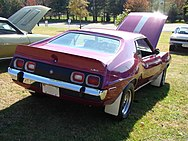 shows the rear end of a 1973 Javelin AMX finished in purple