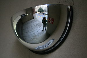 Curved mirror - Convex mirror lets motorists see around a corner.