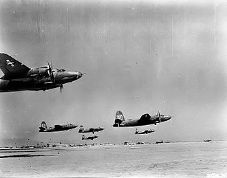 319th Operations Group - 319th Bomb Group B-26 Marauders taking off en-masse from a desert base in North Africa, 1943