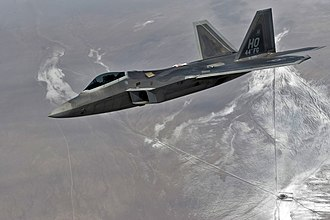 44th Fighter Group - F-22A Raptor assigned to the 44th Fighter Group flies over the Nevada Test and Training Range for a training mission during Red Flag 11-3, 2 March 2011.