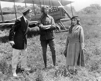 Glenn L. Martin - Kenneth Douglas, Glenn Martin and Mary Pickford in the silent comedy A Girl of Yesterday (Famous Players-Lasky, 1915). A Martin Model TT biplane is behind them.