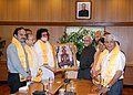 A Jain delegation led by Acharya Lokesh Muni called on the Vice President, Shri Mohd. Hamid Ansari and presented the photograph of Lord Buddha, in New Delhi on April 12, 2014.jpg