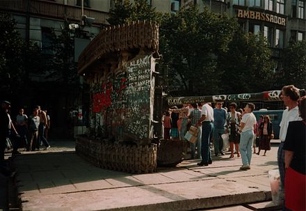 The logo of Solidarnosc painted on an overturned Soviet era T-55 in Prague in 1990 A T-55 on Vaclavske namesti, Prague.jpg