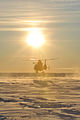A U.S. Coast Guard MH-65 Dolphin helicopter crew lands on an ice sheet near Nome, Alaska, Jan 120118-G-ZQ587-010.jpg
