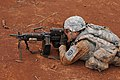 A U.S. Soldier with the 3rd Squadron, 4th Cavalry Regiment, 3rd Brigade Combat Team, 25th Infantry Division aims down the sights of his M249 light machine gun during exercise Bronco Rumble May 12, 2013 130512-A-CJ175-216.jpg