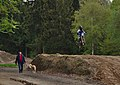A dog, two men, and a dirt bike on the pre-RAVeL L47a and Motocross Recht in Sankt Vith, Belgium (DSCF5690).jpg