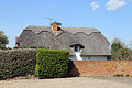 A thatched cottage north from the churchyard at High Easter, Essex, England.jpg