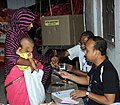 A woman first time voter (under the India-Bangladesh Land Boundary Agreement) being registered her name to cast her vote, at a polling booth, during the sixth phase of West Bengal Assembly Election, at Dinhata constituency.jpg