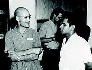 Shreeram Shankar Abhyankar - Shreeram Abhyankar (right) with Alexander Grothendieck (left), Michael Artin in the background, at Montreal, Canada in 1970.