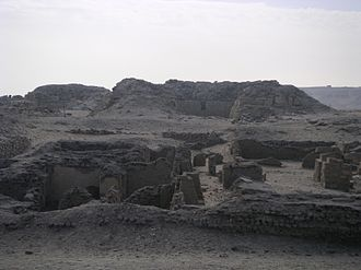 Pyramid of Khentkaus II - Remains of the inner mortuary temple of the pyramid of Khentkaus II. In the background are the ruins of the Lepsius XXIV pyramid and the Double Pyramid.