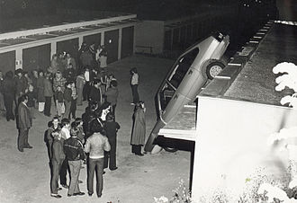 Curiosity - A crowd mills around the site of a car accident in Czechoslovakia in 1980.