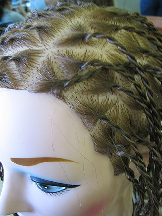 Hair twists - Two-stranded twists demonstrated on a hairstylist's mannequin.