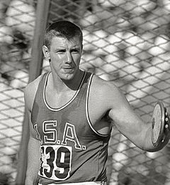 Oerter holding a discus