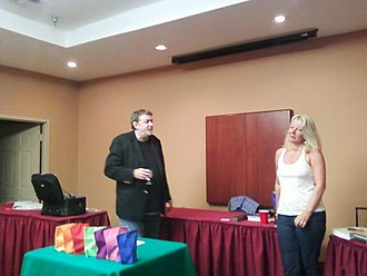 Aldo Colombini - Aldo (left) and his wife, Rachel, lecturing for a magic club in Longview, Texas in Spring 2011