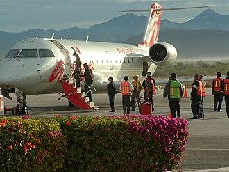 ALMA de México - Passengers disembarking an Alma de Mexico jet at La Paz, Baja California Sur.