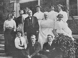 Butler - In a large house, the butler (centre-left) is traditionally head over a full array of household servants.  This is the servant staff at the Stonehouse Hill of Massachusetts, the estate of Frederick Lothrop Ames, 1914.