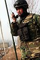 An Afghan commando from the Afghan National Army, 5th Commando Kandak, talks on the radio as a shura takes place in Pul-e Khumri district, Baghlan province, Afghanistan, Feb 120210-A-BT925-008.jpg