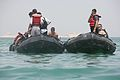 An Iraqi policeman climbs aboard a Zodiac patrol raft during a rescue swimming and conditioning class in Lake Quadsiyah in Haditha, Iraq, July 9, 2008 080709-M-QJ743-003.jpg