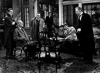 And Then There Were None (1945 film) - From left: Louis Hayward, C. Aubrey Smith, Barry Fitzgerald, Richard Haydn, Mischa Auer, and Walter Huston in And Then There Were None (1945)