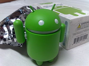 Android (operating system) - Android green figure, next to its original packaging