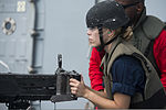 Angelia Carrizosa, a midshipman from Embry Riddle Aeronautical University, fires a M2 .50-caliber machine gun aboard the guided missile destroyer USS Preble (DDG 88) Aug. 7, 2013, while underway in the Soloman 130807-N-TX154-209.jpg