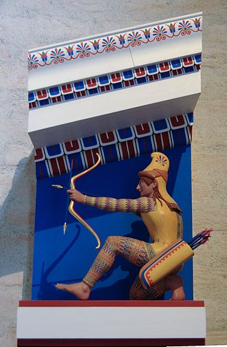 Bow and arrow - Polychrome small-scale model of the archer XI of the west pediment of the Temple of Aphaea, c. 505–500 BCE.